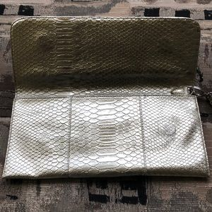 Urban Outfitters Bags - Urban Outfitters Golden Metallic Magnetic Clutch